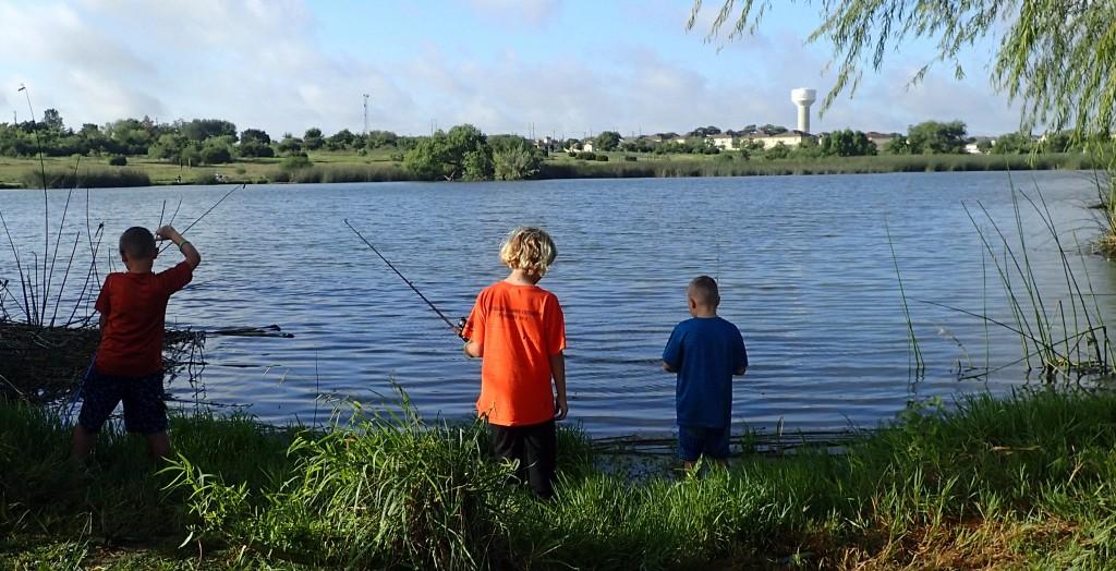 Children fishing on Linebarger Lake shoreline
