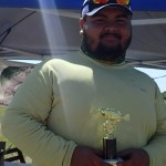 1st Place Adult - Carlos Morales holding trophy